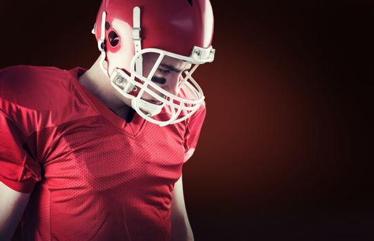 Composite image of american football player taking his helmet on her head