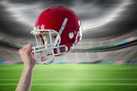 Composite image of helmet of  an american football player