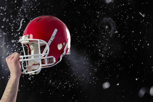 Composite image of a helmet of an american football player