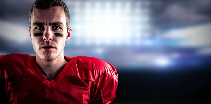 Composite image of portrait of a serious american football player looking at camera