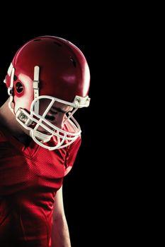 Composite image of amercian football player having his helmet on her head