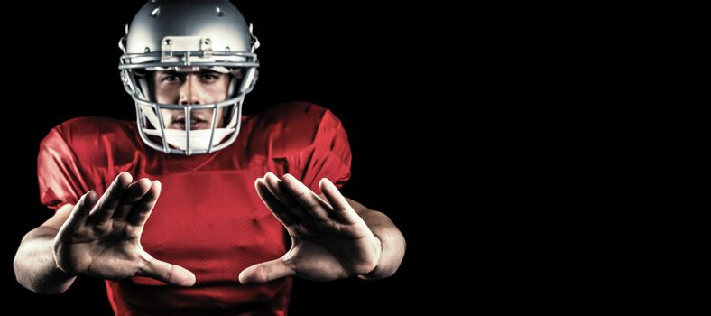 Composite image of portrait of sportsman defending while playing american football