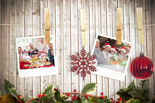 Hanging christmas photos against wooden planks background
