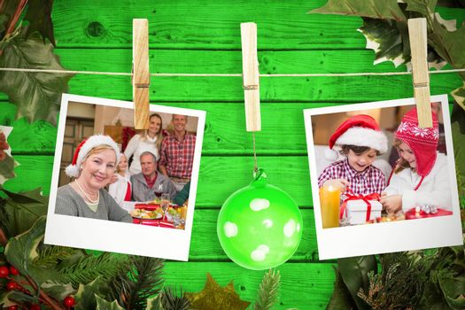 Hanging christmas photos against green wooden planks background