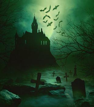 Spoody castle with graveyard down below