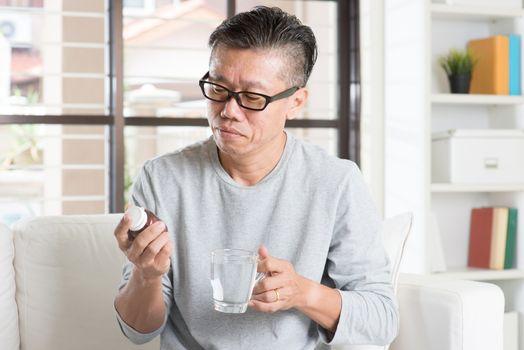 Man eating supplement