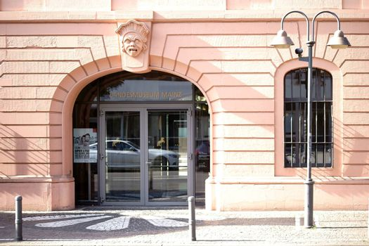 Mainz, Germany - October 2, 2015: The entrance of the Mainz state museum with a head portrait as well as a lantern on the sidewalk on October 02, 2015 in Mainz.