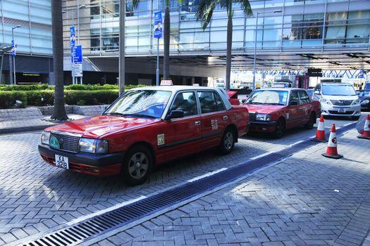 Hong Kong, Hong Kong S.A.R. - December 29, 2014: Red taxi in Hong Kong Airport. Most of the vehicles on Hong Kong's streets are taxis.