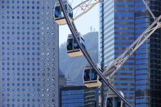 Hong Kong, Hong Kong S.A.R. - December 29, 2014:  Ferris wheel on a background of tall buildings in Hong Kong