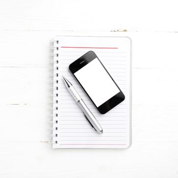 notepad and cellphone