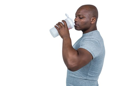 Fit man with protein shake