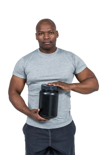 Fit man with protein powder