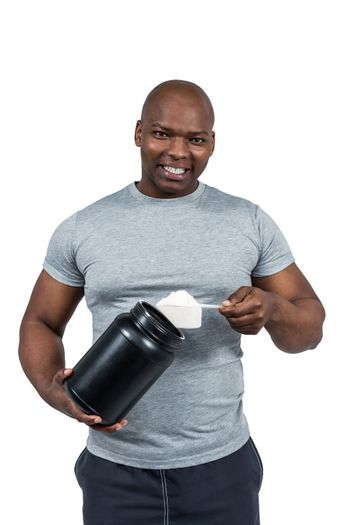Fit man scooping protein powder