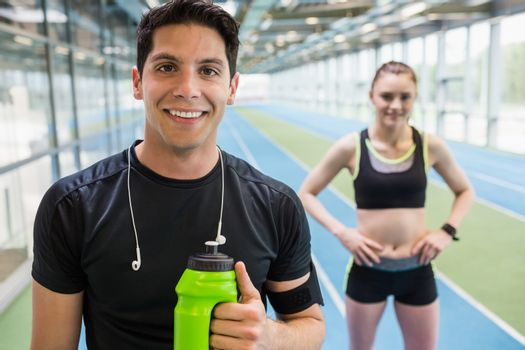 Fit couple on the indoor track