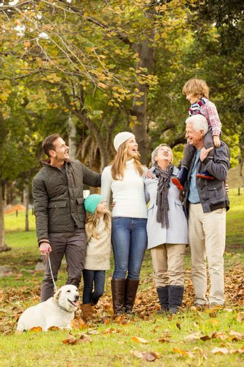 Happy family in the park together on an autumns day