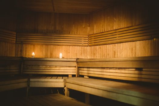 A sauna room with lit candles