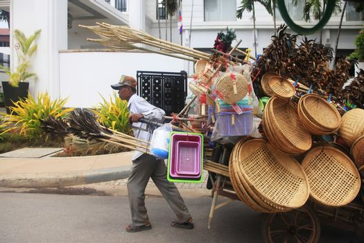 Phnom Penh, Cambodia, April 5th 2014: Seller wicker baskets on the streets of Phnom Penh