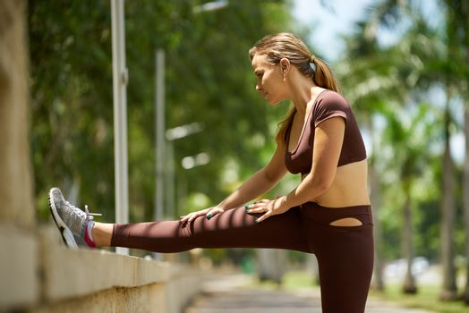 Woman Doing Stretching Before Sports Training At Morning-3