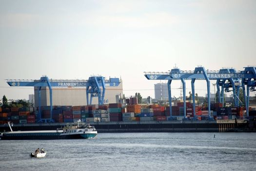 Mainz, Germany - October 2, 2015: The container terminal of the company Frankenbach at the customs and inland port in Mainz with ships and cranes on October 02, 2015 in Mainz.