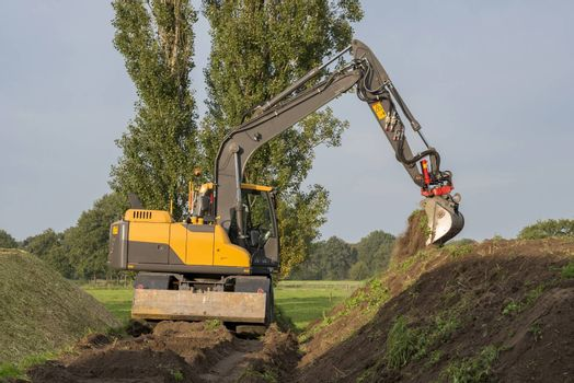 Agriculture shredded corn silage with an excavator in the Netherlands