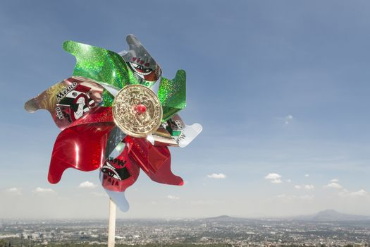 Mexican Rehilete memorial to September 15. Background can appreciate valley of Mexico and the blue sky with clouds