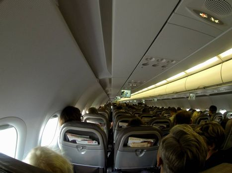 fully loaded airplane with seated passengers