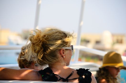 woman with blond hair and sunglasses on holiday