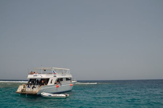 excursion boat with tourists in the Red Sea Reef
