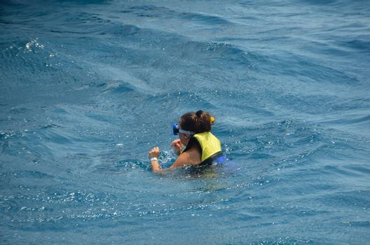 young woman wearing life jacket in the sea in egypt