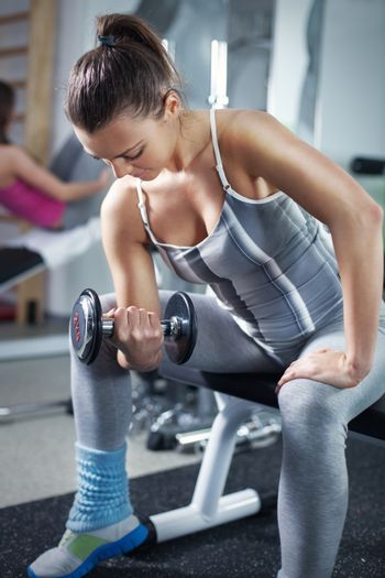 Young Woman Doing Biceps Exercise