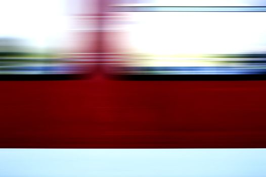 The abstract and colorful movement stripes from a window of a passing train.