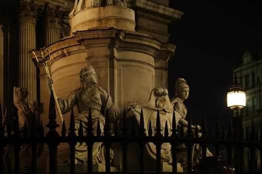 London, UK - November 29, 2014: Illuminated Heraldry and sculptures of the Queen Anne sculpture in front of the St Paul's Cathedral at night on November 29, 2014 in London.