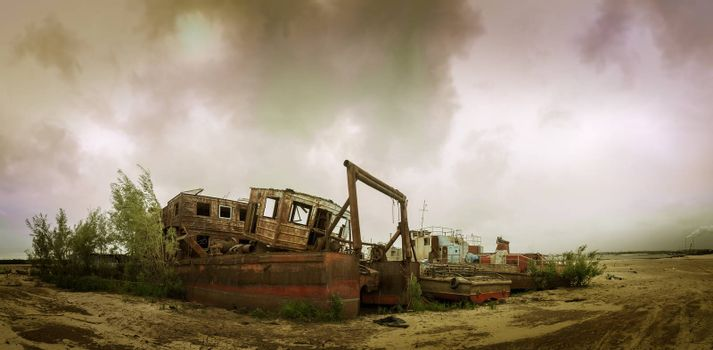 Old wrecked boat on the coast. Autumn sky background.