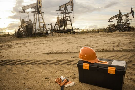 Equipment and tool box on a industrial site background. Oil and gas industry. Small depth of field. Toned.