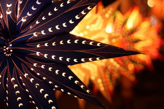 A traditional lantern on the backdrop of other lanterns lit on the ocassion of Diwali festival in India.