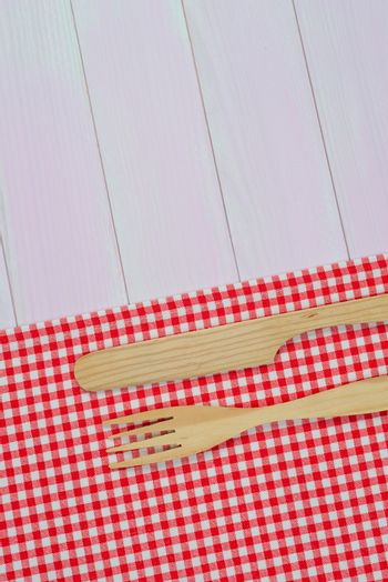 Kitchenware on red towel