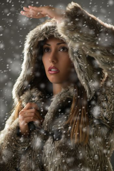 Girl Finding Her Way Through Blizzard