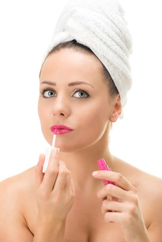 Woman Putting Lip Gloss