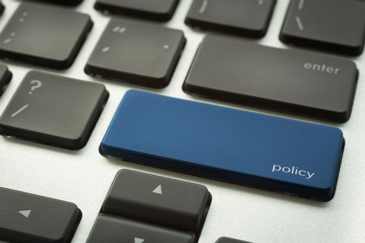 Laptop keyboard with typographic POLICY button