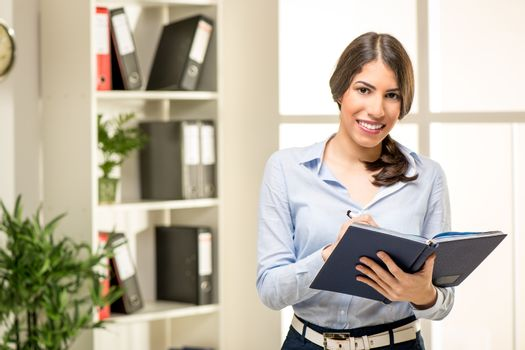 Young Businesswoman With Planner