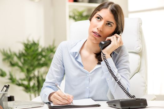 Businesswoman Phoning In The Office