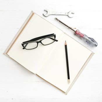 notebook with wrench