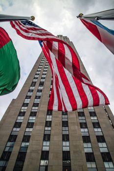 Rockfeller Center Building Perspective with flags Manhattan