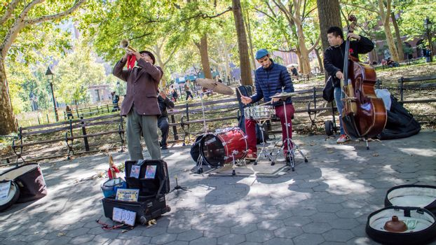 NEW YORK, USA, October 10, 2015: An unidentified group of musicians perform their songs in Washington Square Garden in Manhattan, New York.