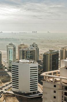 Dubai skyline, United Arab Emirates. Desert and city.