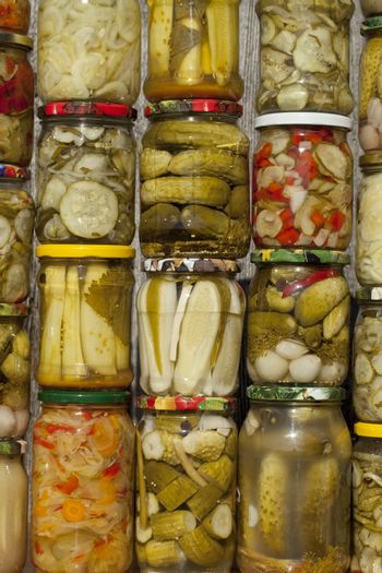 vegetables different species marinated in jar as background