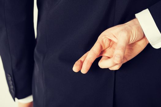 man with crossed fingers