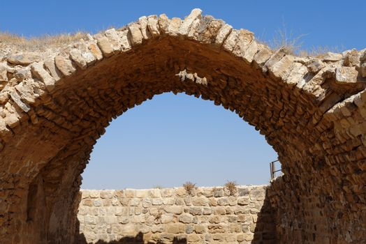 Ancient stone arch and wall of Kerak Castle in Jordan
