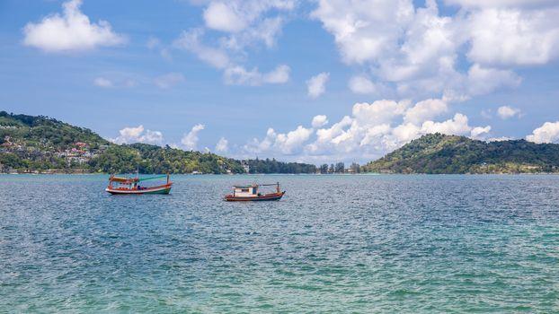 Small fishing boats near the island of Phuket sea. Thailand