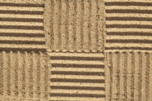 pattern in checked with sand as background